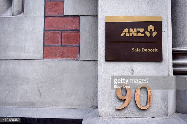 A sign for Australia New Zealand Banking Group Ltd's safe deposit service is displayed outside a bank branch in Melbourne Australia on Friday May 1...