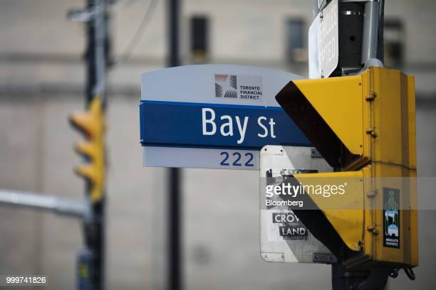 A sign for Bay Street hangs in the financial district of Toronto Ontario Canada on Wednesday July 11 2018 Canadian stocks were mixed Friday as health...