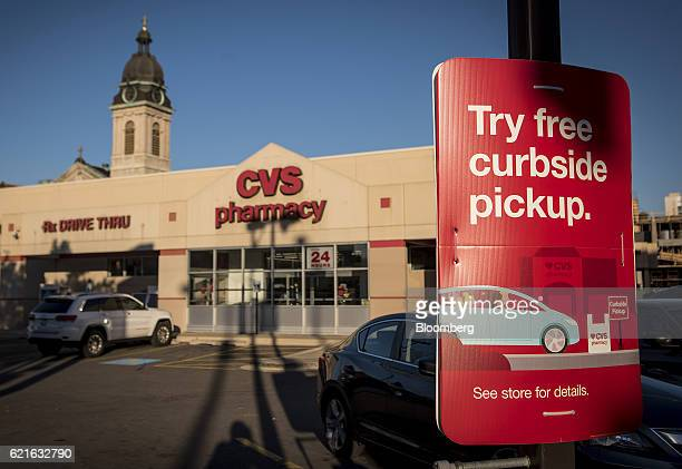 A sign for curbside pickup is displayed outside of a CVS Health Corp store in Chicago Illinois US on Sunday Nov 6 2016 CVS Health Corp is scheduled...