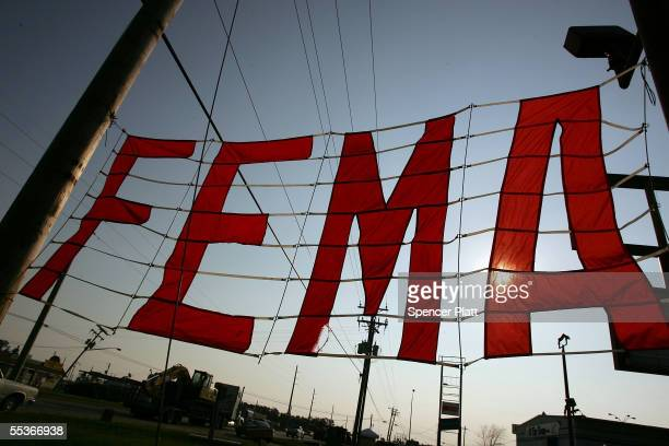 Sign for FEMA hangs at the entrance to a disaster assistance distribution point September 10, 2005 in Waveland, Mississippi. Thousands of residents...