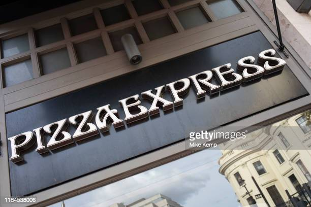 Sign for food chain Pizza Express in London United Kingdom PizzaExpress is a restaurant group with over 470 restaurants across the United Kingdom and...