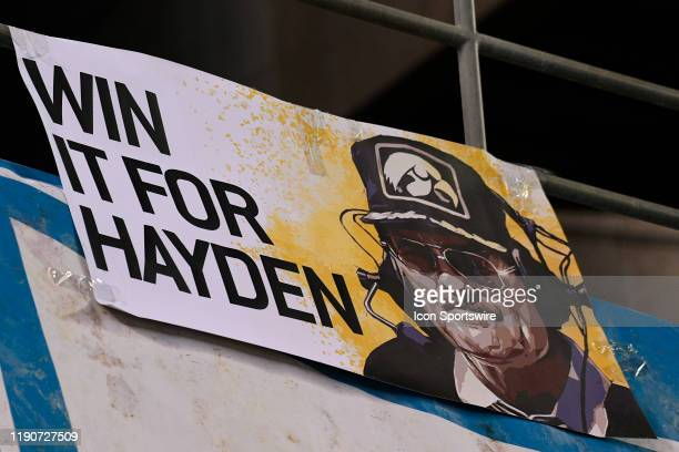 A sign for former Iowa coach Hayden Fry who recently passed away during the San Diego County Credit Union Holiday Bowl football game between the USC...