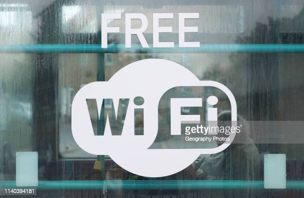 Sign for Free Wi Fi on glass window public transport bus, Suffolk, England, UK.