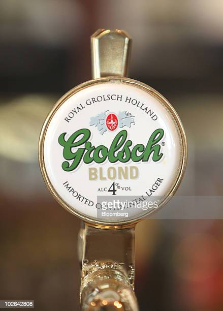A sign for Grolsch Blond beer produced by SAB Miller Plc sits on a beer tap in London UK on Tuesday July 6 2010 Punch Taverns Plc the largest UK pub...