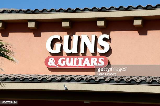 A sign for Guns Guitars a gun shop where suspected Las Vegas gunman Stephen Paddock allegedly purchased firearms October 2 2017 in Mesquite Nevada...