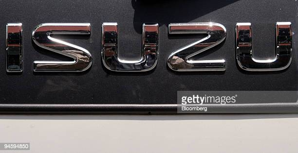 A sign for Isuzu Motors Ltd is seen in Tokyo Japan on Monday May 14 2007 Isuzu Motors Ltd Japan's biggest maker of lightduty trucks increased profit...