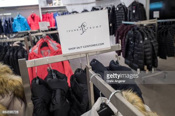 A sign for Ivanka Trump brand is displayed atop a rack of Ivanka Trump brand coats for sale at the Century 21 department store February 10 2017 in...