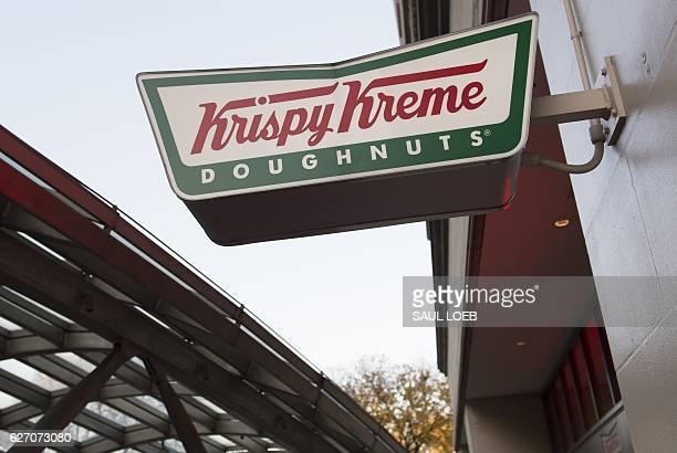 Sign for Krispy Kreme doughnuts is seen outside their store in Washington, DC, December 1, 2016. / AFP / SAUL LOEB