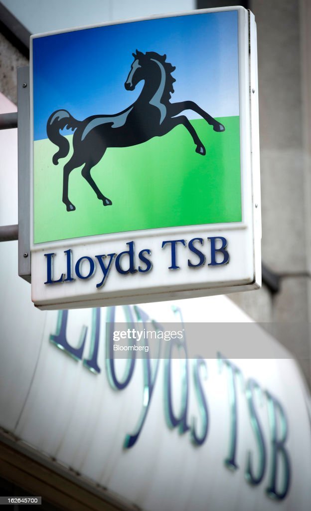 A sign for Lloyds TSB bank, part of the Lloyds Banking Group Plc, is seen outside a branch on Oxford Street in central London, U.K., on Monday, Feb. 25, 2013. U.K. Chancellor of the Exchequer George Osborne won't bow to opposition calls to change economic plans after the decision by Moody's Investors Service to strip the U.K. of its Aaa status. Photographer: Jason Alden/Bloomberg via Getty Images