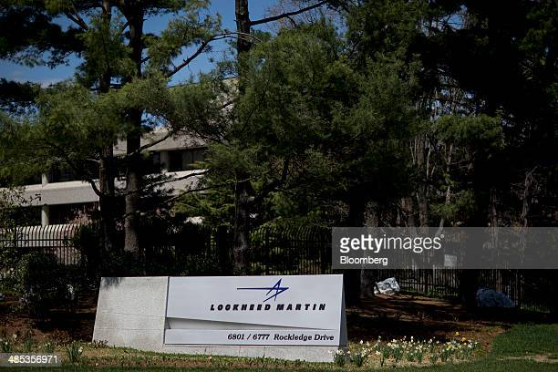 Sign for Lockheed Martin Corp. Stands outside the company's headquarters in Bethesda, Maryland, U.S., on Thursday, April 17, 2014. Lockheed Martin is...
