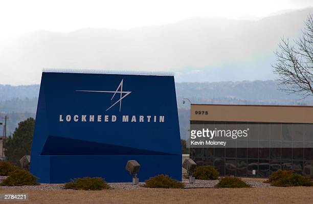 A sign for Lockheed Martin is seen December 4 2003 in Colorado Springs Colorado Officials from Lockheed Martin demonstrated their new Total...