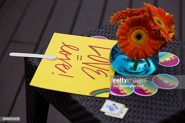 A sign for marriage equality rests on a table with stickers and event planning business cards during a ceremony commending LGBT ally support on the...