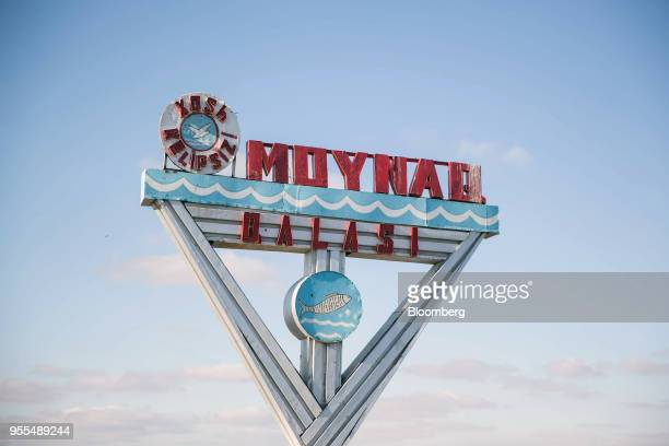 A sign for Moynaq stands in Moynaq Uzbekistan on Wednesday March 14 2018 The drying up of the Aral Sea led to the economic demise of Moynaq once a...