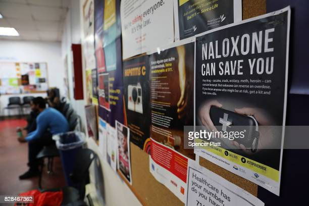 A sign for Naloxone hangs on a wall as students learn to put together a Naloxone spray gun in a class on opioid overdose prevention held by nonprofit...