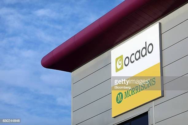 A sign for Ocado and Wm Morrisons Supermarkets Plc hangs outside the main entrance to the Ocado Group Plc distribution centre in Dordon UK on Friday...