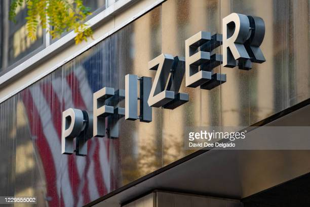 Sign for Pfizer is seen outside the Pfizer headquarters on November 9, 2020 in New York City. Pharmaceutical company Pfizer announced positive early...