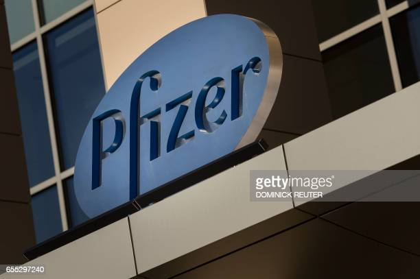 A sign for Pfizer pharmaceutical company is seen on a building in Cambridge Massachusetts on March 18 2017