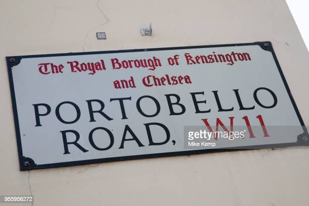 Sign for Portobello Road in Notting Hill West London England United Kingdom People enjoying a sunny day out hanging out at the famous Sunday market...