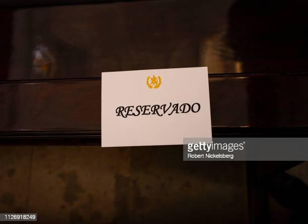 Sign for reserved seating lies on a pew during a funeral service for former Guatemalan Vice President Juan Francisco Reyes, 1939-2019, held at the...