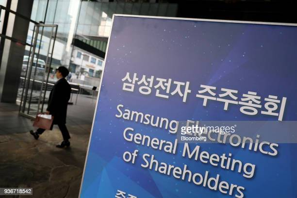 A sign for Samsung Electronics Co's annual general meeting is displayed at the company's Seocho office building in Seoul South Korea on Friday March...