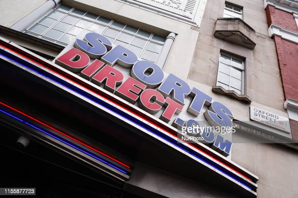 A sign for sporting goods retailer Sports Direct owned by high street tycoon Mike Ashley sits above the entrance to the chain's store on Oxford...