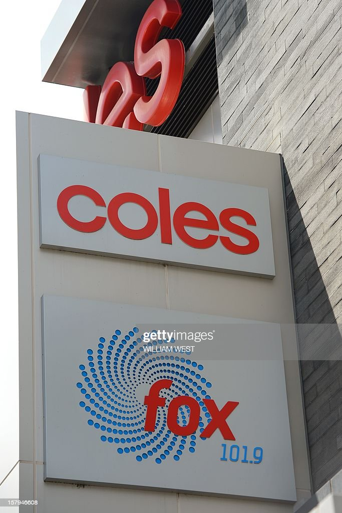 A sign for supermarket giant Coles (top) is dislpayed above a sign for a Southern Cross Austereo radio station (bottom) in Melbourne on December 8, 2012. Coles announced they would withdraw advertising from Southern Cross Austereo after two Australian radio presenters duped a woman working at a London hospital which treated Prince William's pregnant wife Catherine and who was later found dead. Media reports said Jacintha Saldanha, who had worked at the King Edward VII hospital in London for four years, had committed suicide while police said they were treating the death as unexplained. Saldanha had accepted the hoax call from two radio presenters from Sydney's 2Day FM pretending to be Queen Elizabeth II and William's father Prince Charles, before passing it onto a colleague who divulged details of Kate's condition. AFP PHOTO/William WEST