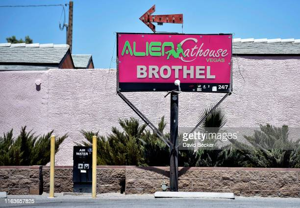 A sign for the Alien Cathouse brothel is seen next door to a convenience store named the Area 51 Alien Center located along US highway 95 on July 21...
