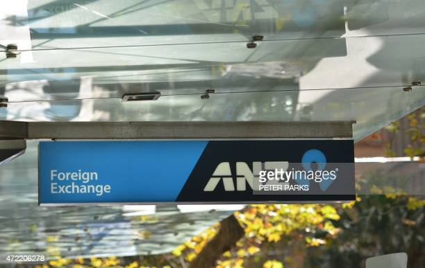 A sign for the Australia and New Zealand Banking Group is seen outside a branch in Sydney on May 5 2015 ANZ posted a modest first half net profit...