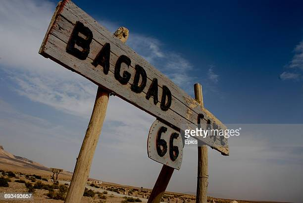 Sign for the Bagdad Café, which is 172 km from the Iraqi border. The café is popular with backpackers and is located near Palmyra, Syria.
