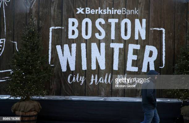 A sign for the Boston Winter holiday festival welcomes visitors to City Hall Plaza in Boston on Dec 21 2017 Winter can turn Bostons City Hall Plaza...