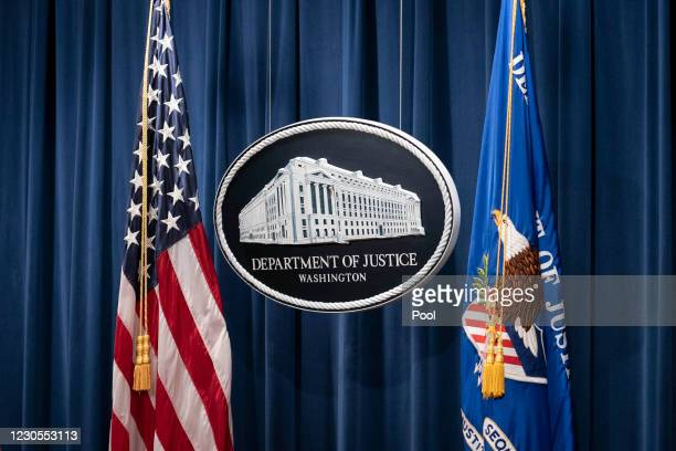 Sign for the Department of Justice is seen before Steven D'Antuono, FBI Washington field office Assistant Director in Charge and Michael Sherwin,...