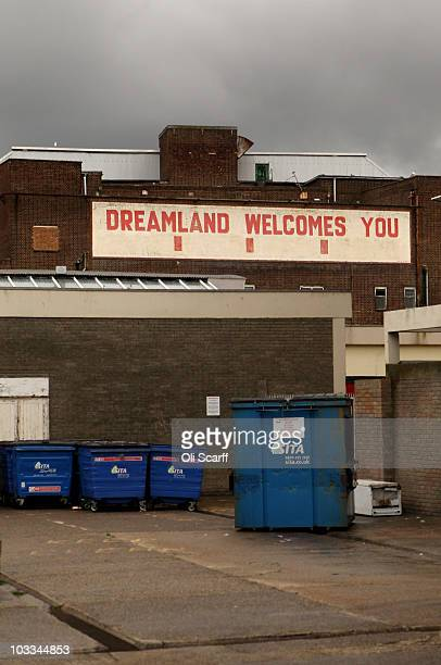 A sign for the derelict Dreamland amusement park is seen behind bins adjacent to Margate beach front on August 10 2010 in Margate England The Kentish...