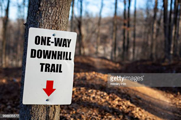 sign for the downhill mountain biking trail in northwest arkansas - bentonville stock photos and pictures