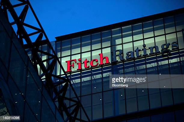 A sign for the financial agency Fitch Ratings Ltd located within 30 North Colonnade is seen on a building at the Canary Wharf business and shopping...