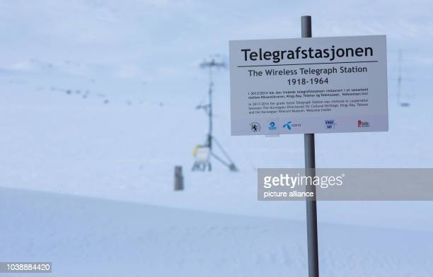 A sign for the former telegrpah station can be seen on Spitsbergen in NyAelesund Norway 09 April 2015 Arctic research stations occupied by Norway...
