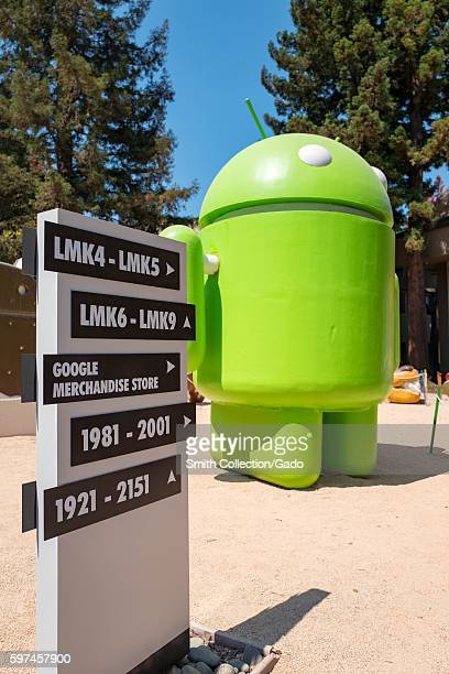 A sign for the Google Merchandise Store with a sculpture representing the Android cellphone operating system at the Googleplex headquarters of the...