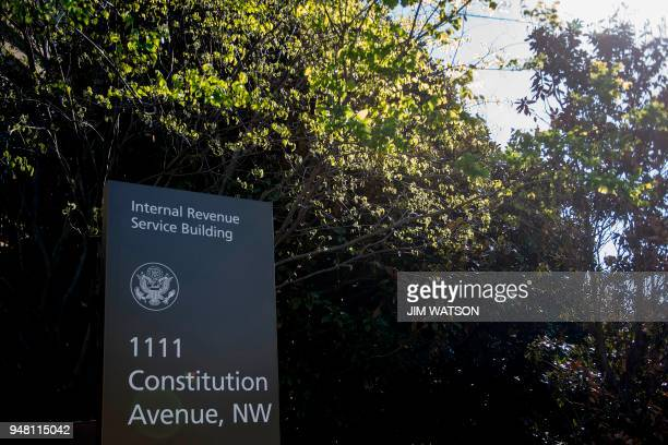A sign for the Internal Revenue Service building is viewed in Washington DC on April 18 2018 Americans are getting an extra day to file their taxes...