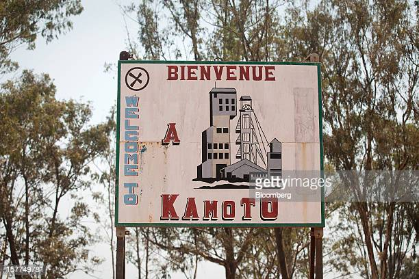 A sign for the Kamoto Copper Co stands outside Katanga Mining Ltd's copper and cobalt mine in Kolwezi Katanga province Democratic Republic of Congo...