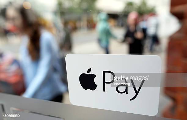 A sign for the launch of the Apple pay system from AppleInc is seen displayed at the entrance to a McDonald's Corp restaurant in London UK on Tuesday...