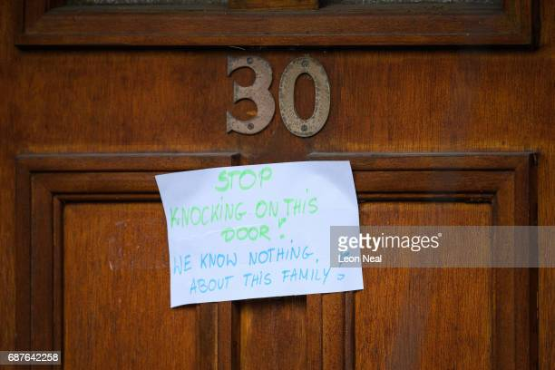 A sign for the media is seen on a neighbour's door as forensic teams search the former home of terrorist Salman Abedi on May 24 2017 in Manchester...