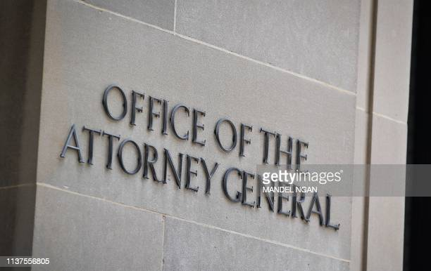 A sign for the Office of the Attorney General is seen at the Department of Justice in Washington DC is seen on April 16 2019 A redacted version of...