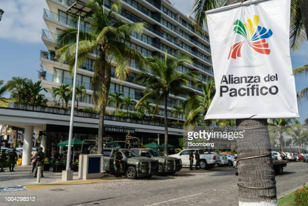 Members of the Mexican army stand guard along a street during the Pacific Alliance Summit in Puerto Vallarta Jalisco state Mexico on Monday July 23...