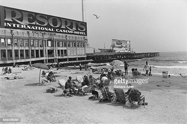Sign for the Resorts Casino Hotel on the beach in Atlantic City, New Jersey, 30th July 1983.