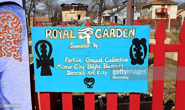 A sign for the Royal Garden an urban garden maintained by Blight Busters is displayed at the entrance in Detroit Michigan US on Saturday March 23...