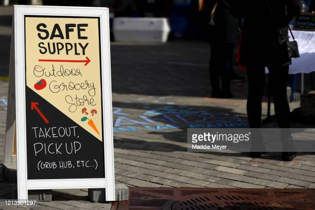 A sign for the Safe Supply outdoor grocery store at Bow Market on March 21 2020 in Somerville Massachusetts In order to comply with the city of...