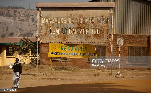 A sign for the stateowned mining company Gecamines or La Generale des Carrieres des Mines stands at the entrance to Katanga Mining Ltd's copper and...