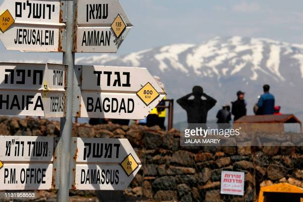 Sign for tourists shows the direction to Jerusalem, Amman, Baghdad and Damascus among other destinations at an army post on Mount Bental in the...