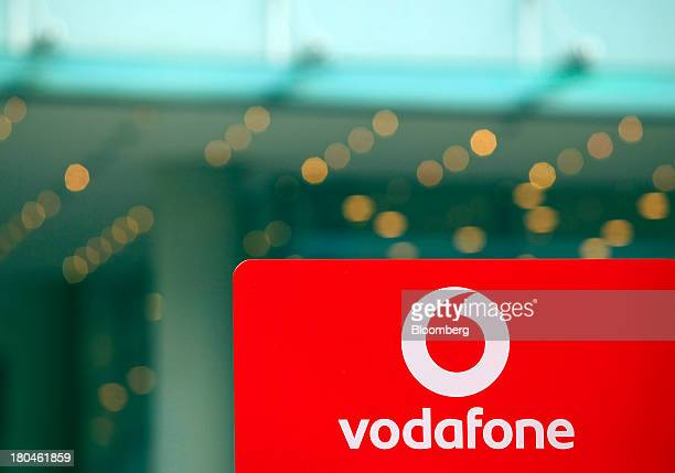 A sign for Vodafone is seen in the window of a store operated by Vodafone Group Plc in Leipzig Germany on Thursday Sept 12 2013 Vodafone Group Plc's...