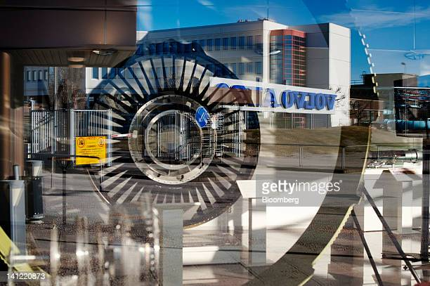 A sign for Volvo Aero a division of Volvo AB is reflected in the window of the site museum at the company's factory in Trollhaettan Sweden on Monday...