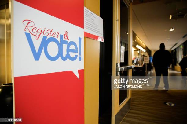 Sign for voter registration is pictured on Election Day at the King County Elections office in Renton, Washington on November 3, 2020. - Americans...